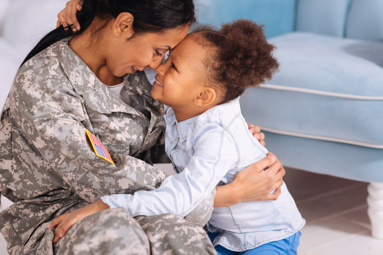 Active-duty military parent Hugging Young Daughter
