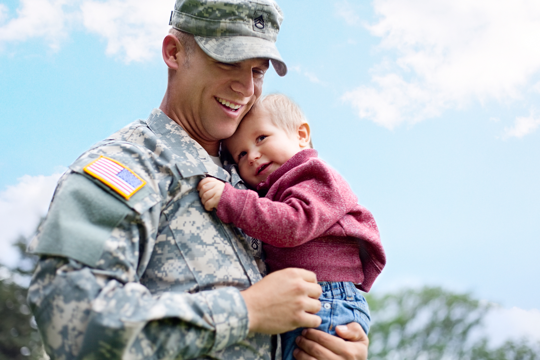 Soldier Holding Toddler