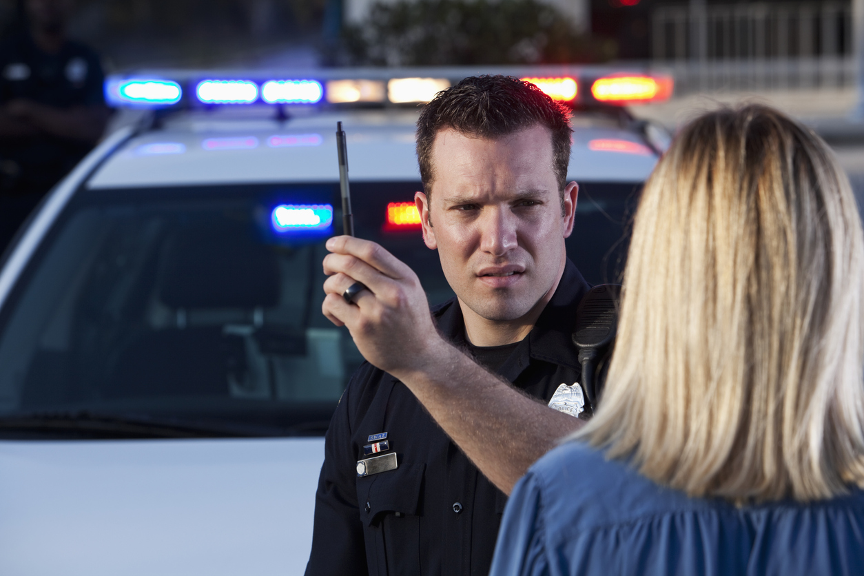 Police officer administering sobriety field test
