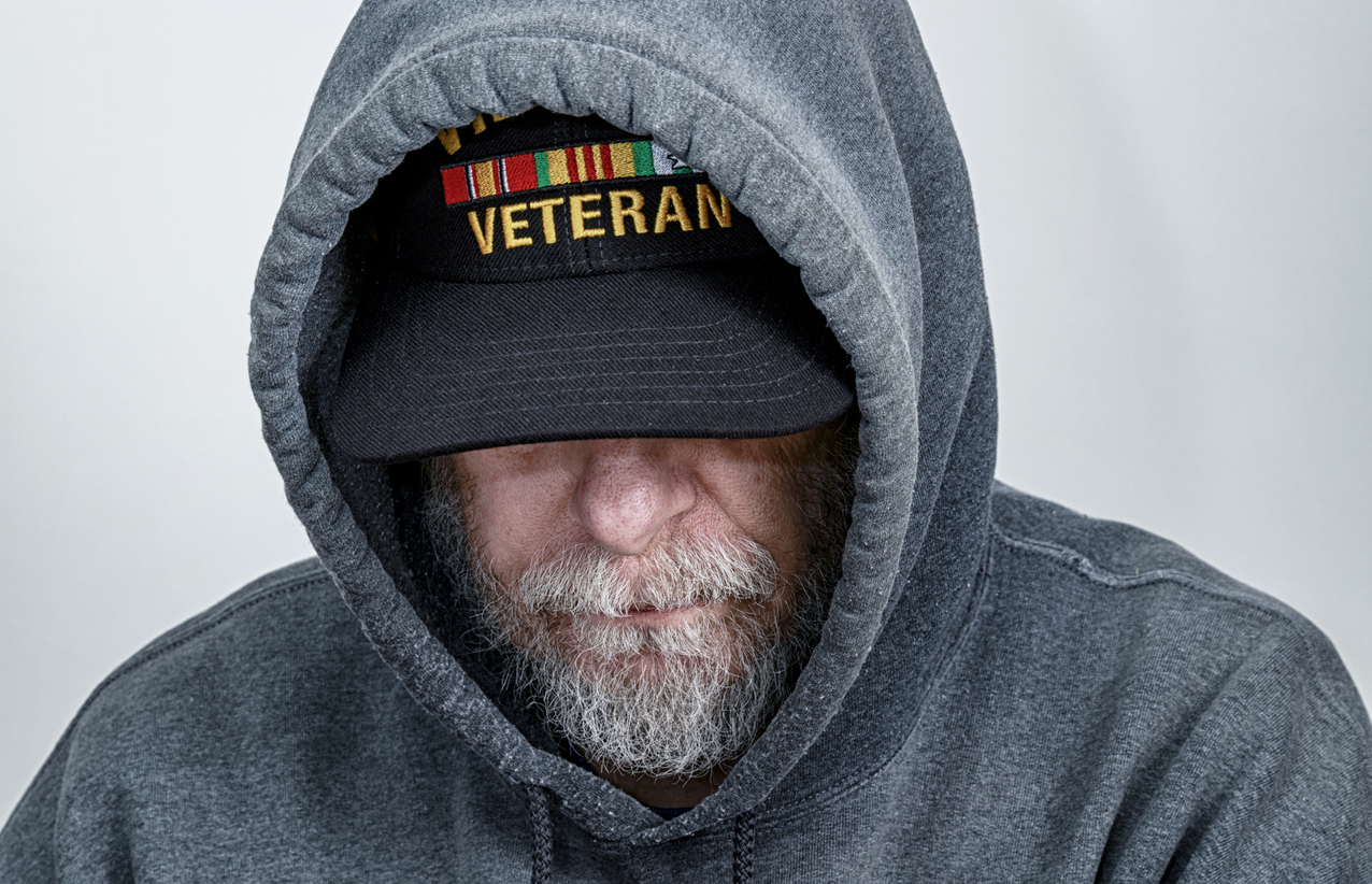 A military veteran wearing his veteran hat